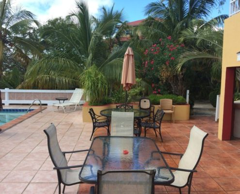 The pool deck and tables at Provo Villa