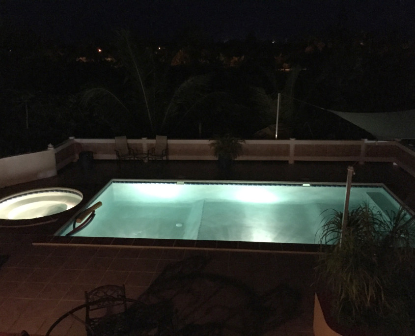 Pool lights at night at ProvoVilla on Providenciales